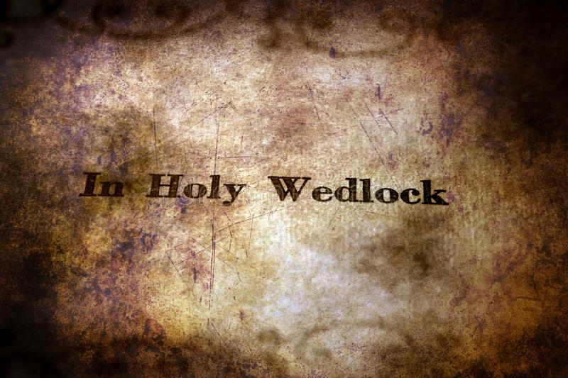Holy wedlock text on grunge background.  royalty free stock image