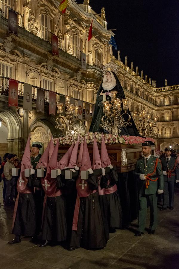 Holy Wednesday Procession in Salamanca, Spain. Salamanca, Spain; March 2017: Brotherhood of Our Father Jesus Flagelado and Our Lady of Tears, parading the night royalty free stock photography