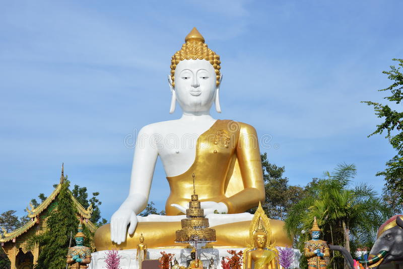 Holy white Buddha image in Wat Phrathat Doi Kham ancient temple in Thailand stock images
