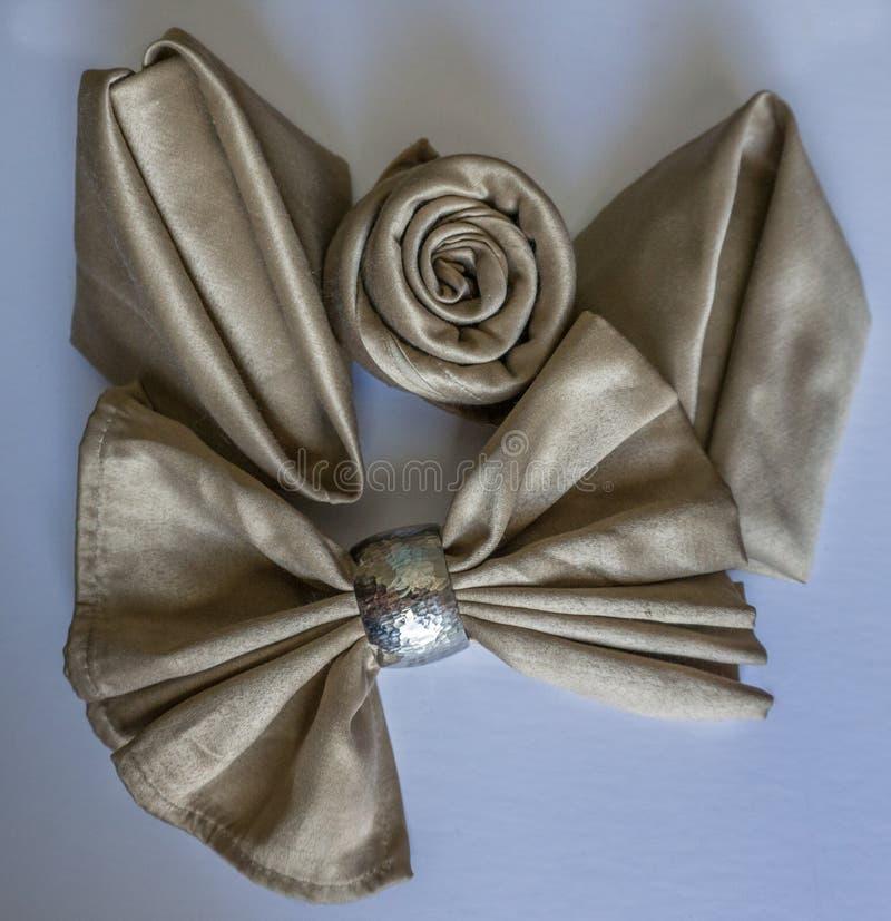 holyday特别党的事件或庆祝的发光的金黄三不同原始的美好的欢乐餐巾可折叠 免版税库存照片