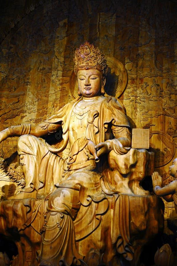 Holz-Schnitzen von Buddha stockfotografie