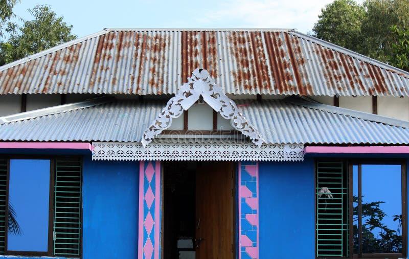 Holzhaus in Bangladesch stockbild