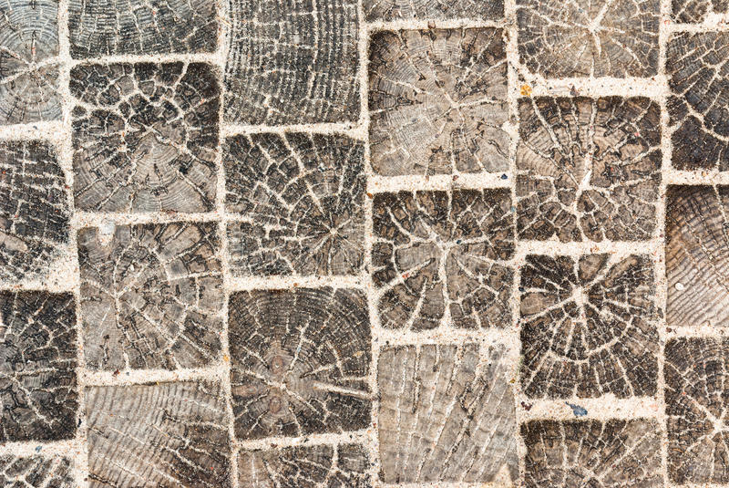 Holzklotzpflasterung mit Sand lizenzfreies stockbild