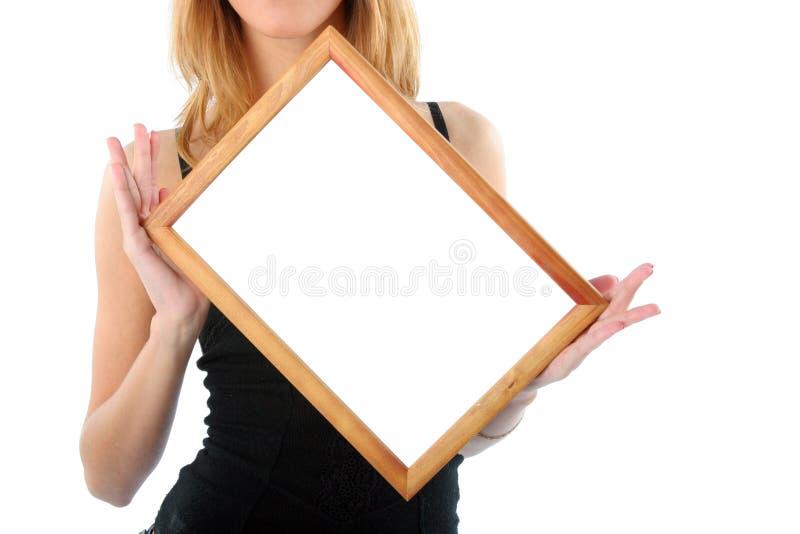 Holzrahmen in den Händen stockbilder