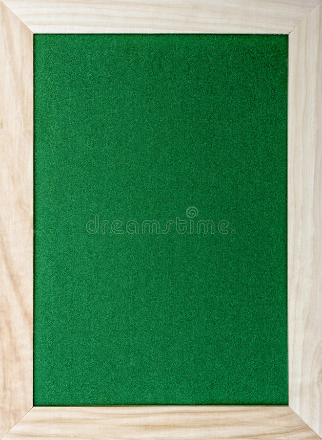 Holzrahmen um grünes glittery Papier lizenzfreies stockfoto