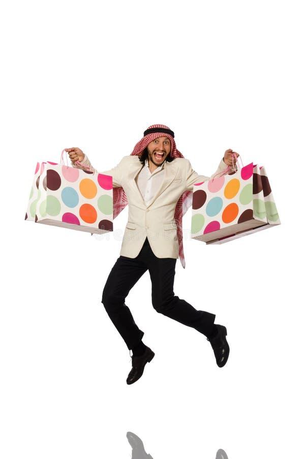Hombre árabe con los panieres en blanco imagen de archivo