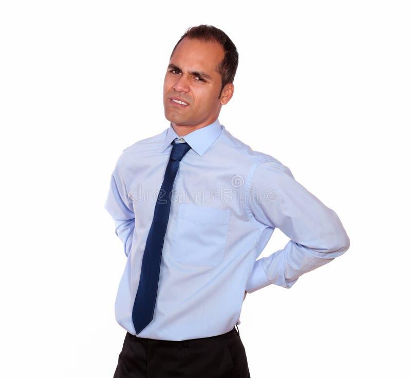 Hombre adulto del cansancio con dolor de espalda imágenes de archivo libres de regalías