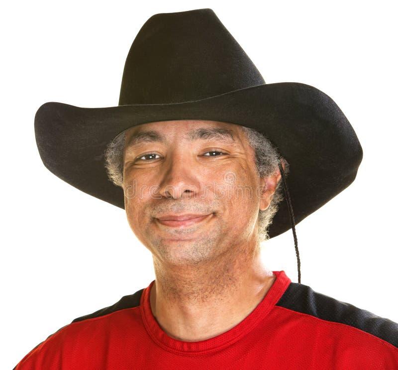 Hombre alegre en el vaquero Hat fotos de archivo