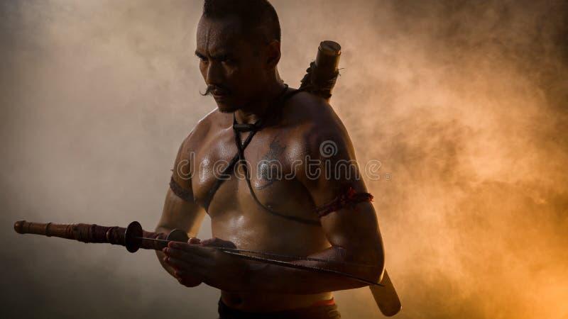 Hombre antiguo del guerrero de soldado del distrito Tailandia de Rachan de la explosión imagen de archivo