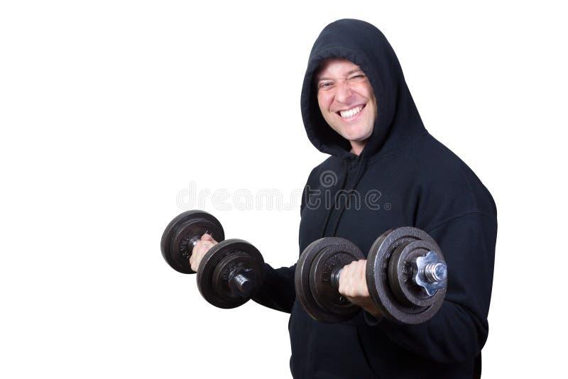 Hombre apto que ejercita con las pesas de gimnasia aisladas en blanco foto de archivo libre de regalías