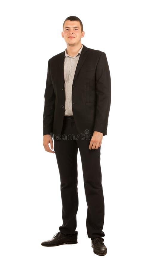 Hombre apuesto sonriente de los jóvenes en traje corporativo imagen de archivo libre de regalías