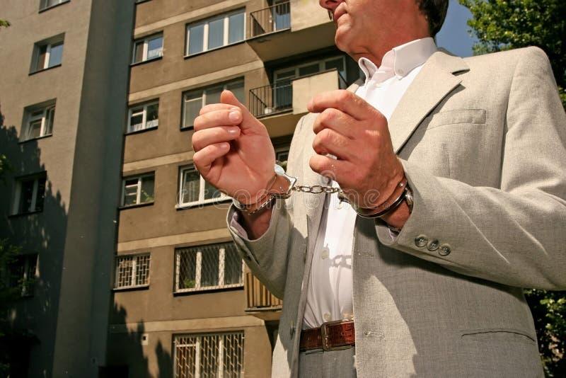 Hombre arrestado imagen de archivo