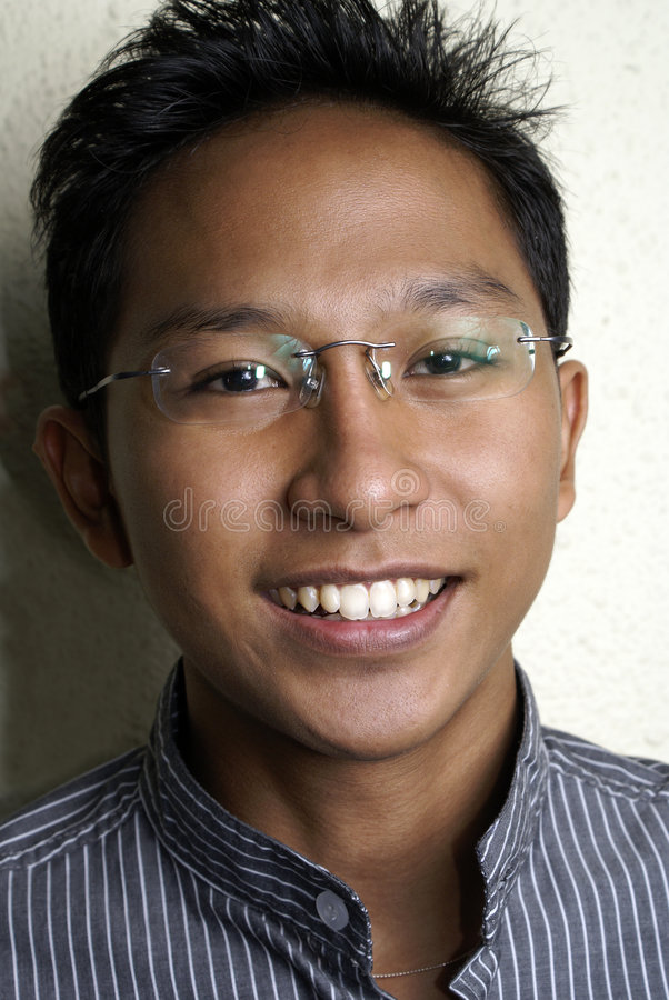 Hombre asiático cómodo fotos de archivo libres de regalías