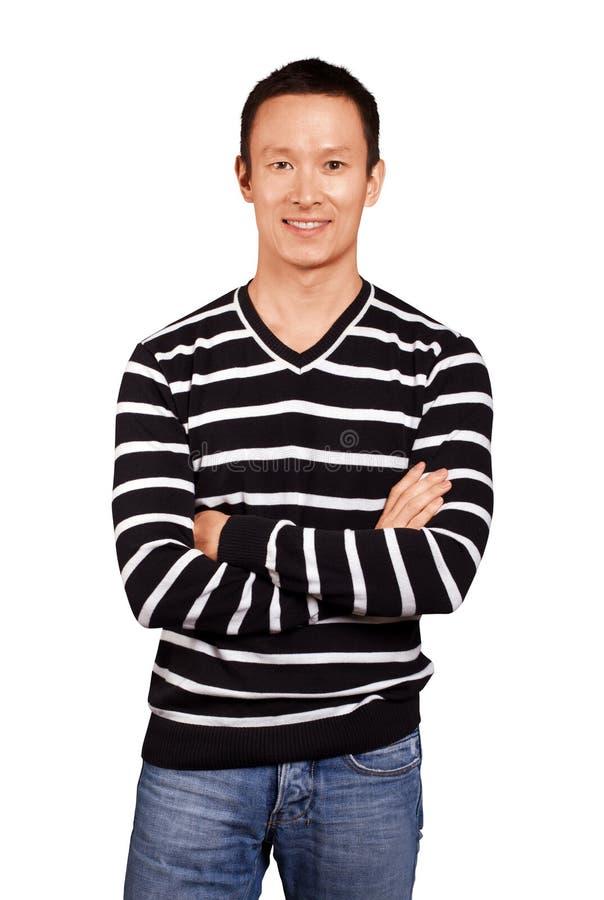 Hombre asiático en jersey rayado imagen de archivo libre de regalías