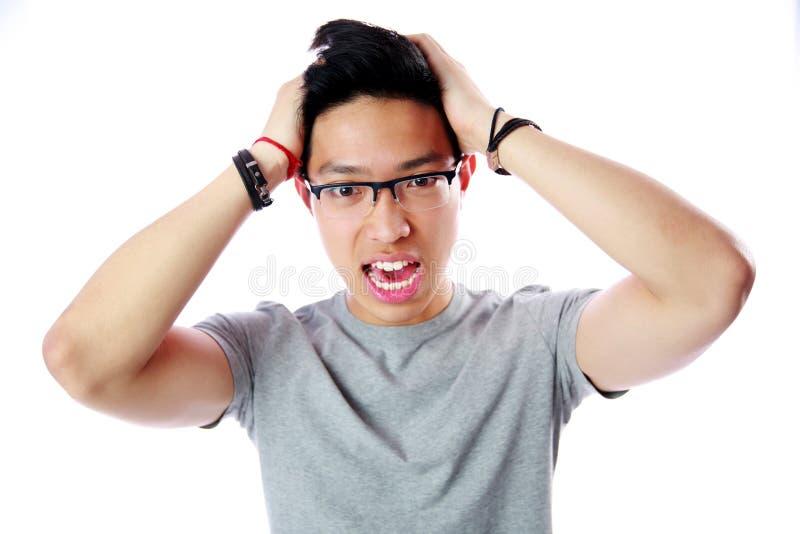 hombre asiático joven asustado fotos de archivo