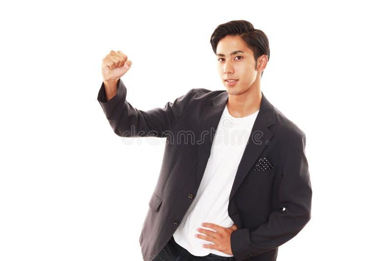 Hombre asiático sonriente foto de archivo