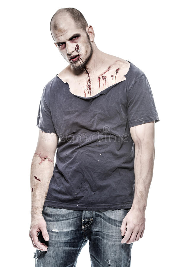 Hombre asustadizo y sangriento del zombi fotografía de archivo