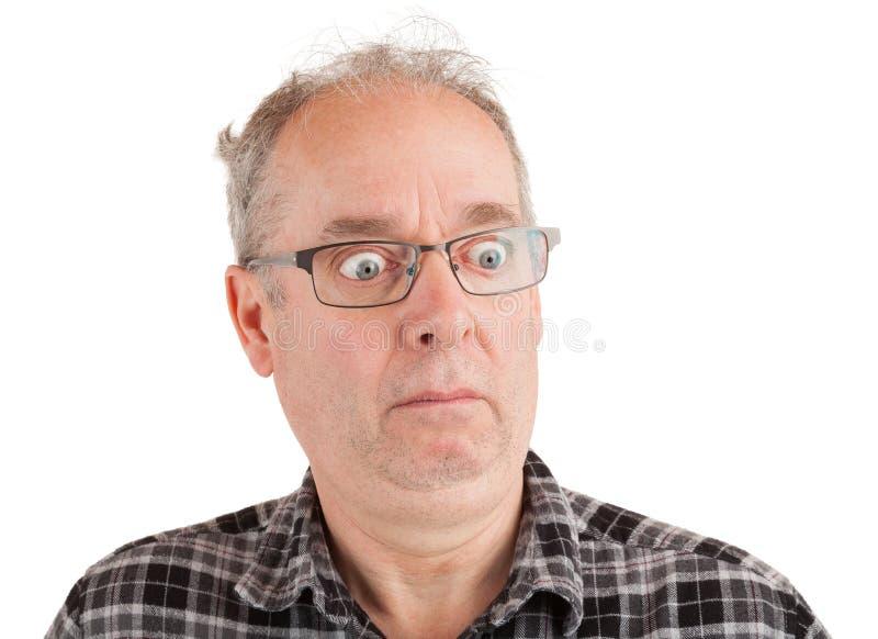 Hombre asustado sobre algo fotos de archivo libres de regalías