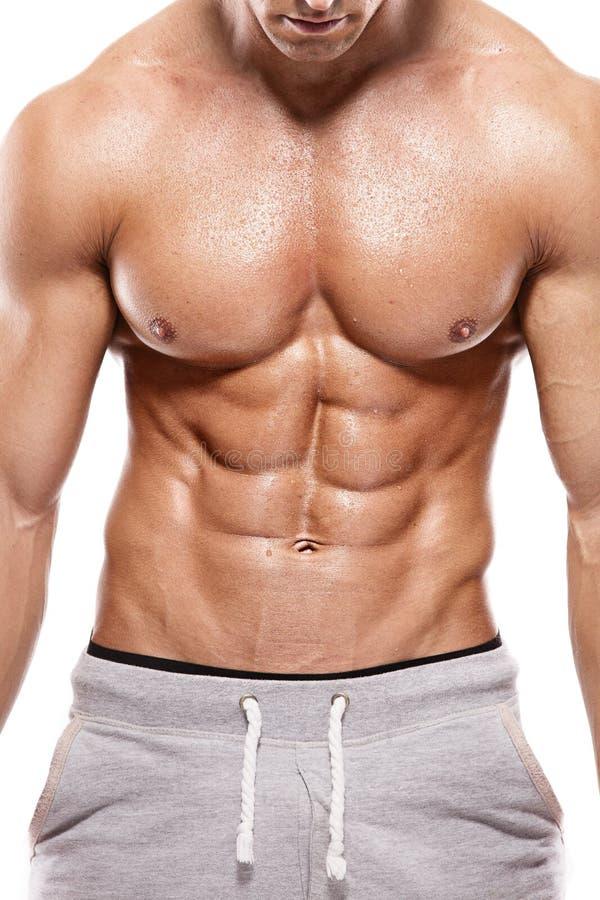 Hombre atlético fuerte que muestra el cuerpo muscular fotografía de archivo