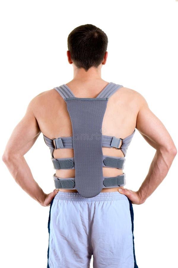 Hombre atlético que lleva el apoyo trasero de apoyo fotos de archivo