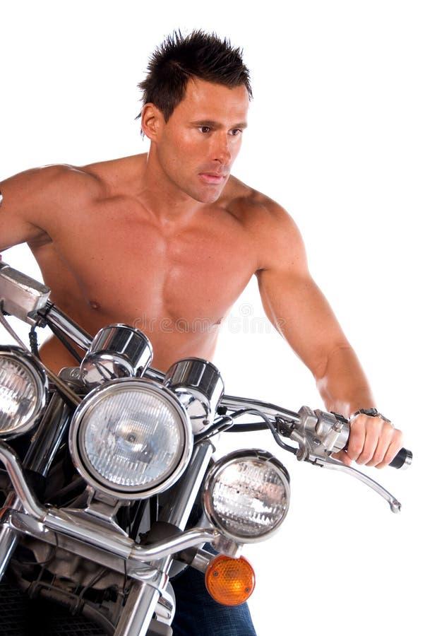 Hombre atractivo del motorista. foto de archivo