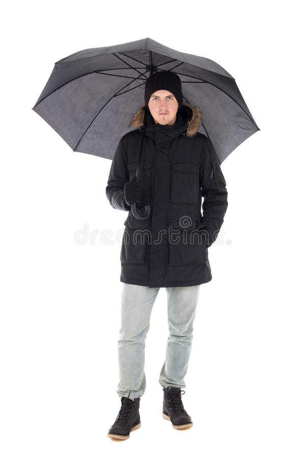 Hombre atractivo joven en chaqueta negra del invierno con el isolat del paraguas imagen de archivo libre de regalías