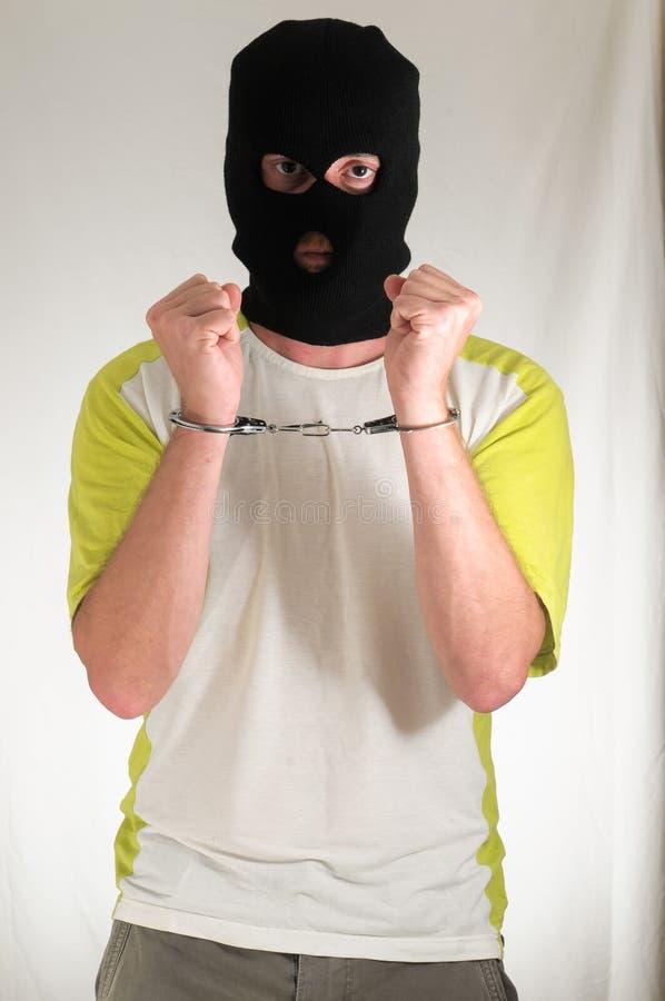 Hombre atrapado en Hancduffs foto de archivo libre de regalías