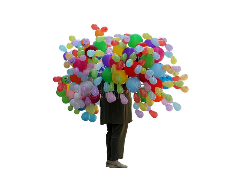 Hombre bajo la forma de árbol de bolas inflables foto de archivo