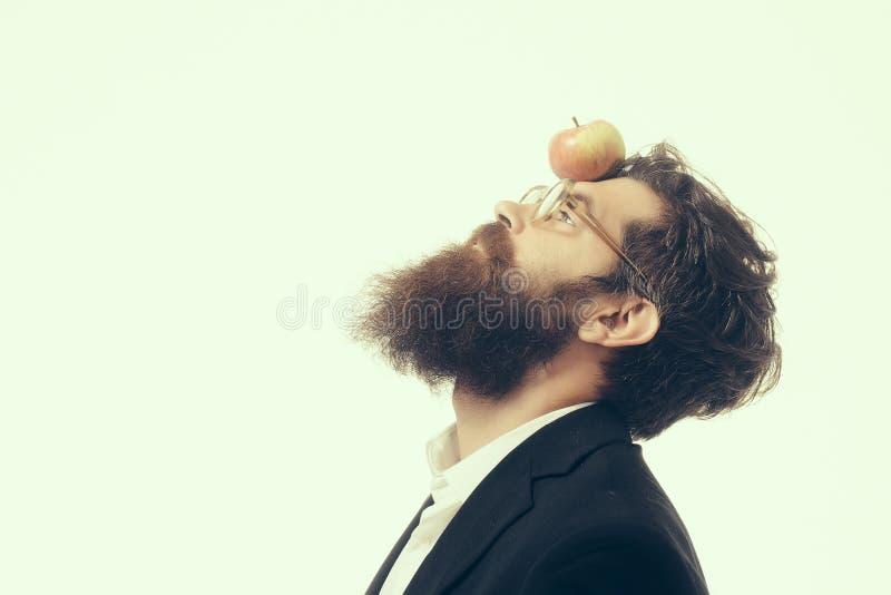 Hombre barbudo con la lámpara como símbolo de la ley de los neutonios imagenes de archivo