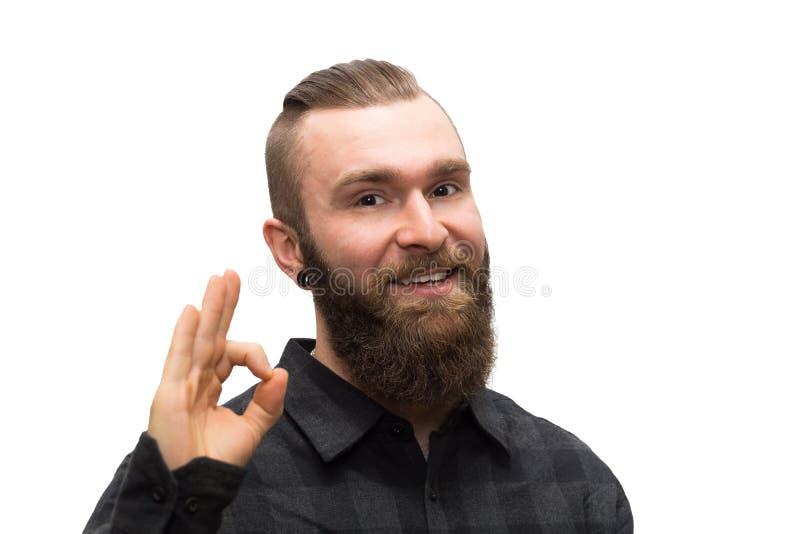 Hombre barbudo en un fondo blanco imagenes de archivo
