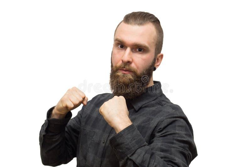 Hombre barbudo en un fondo blanco imagen de archivo