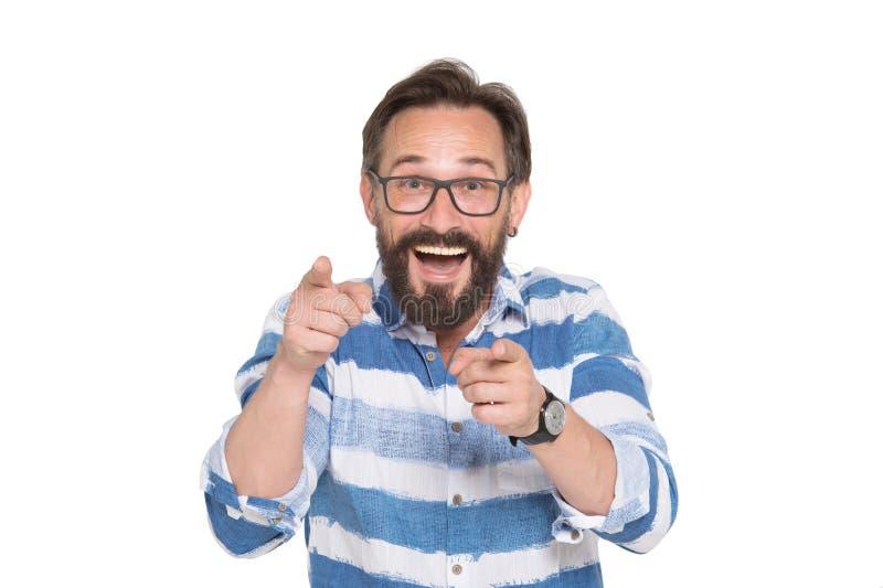 Hombre barbudo inteligente encantado que señala en usted con dos índices imagen de archivo libre de regalías
