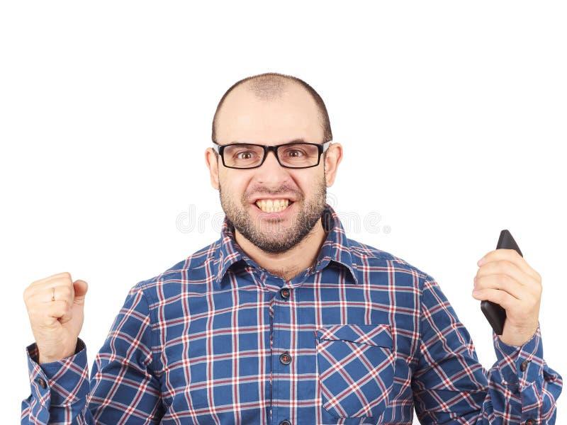 Hombre calvo enojado en vidrios imagen de archivo