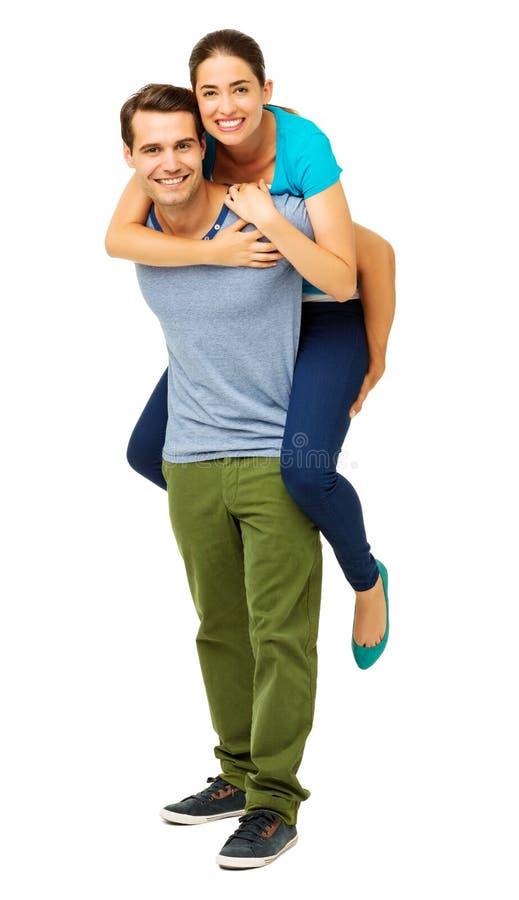 Hombre cariñoso que lleva a cuestas a la mujer foto de archivo