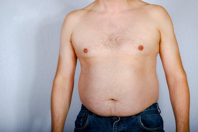 Hombre caucásico gordo descamisado fotografía de archivo