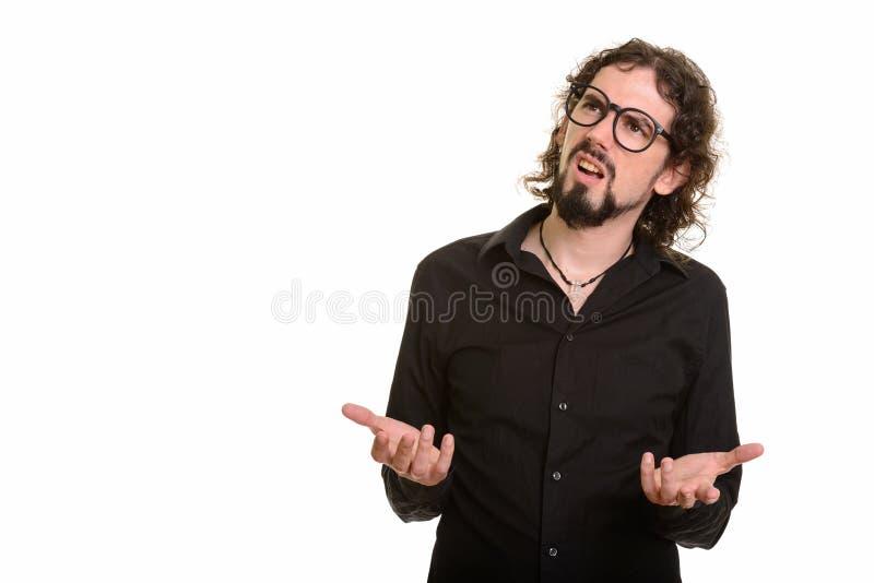 Hombre caucásico hermoso que parece confuso mientras que piensa fotografía de archivo