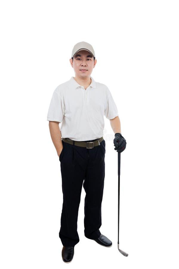 Hombre chino asiático sonriente que presenta con el club de golf fotografía de archivo libre de regalías
