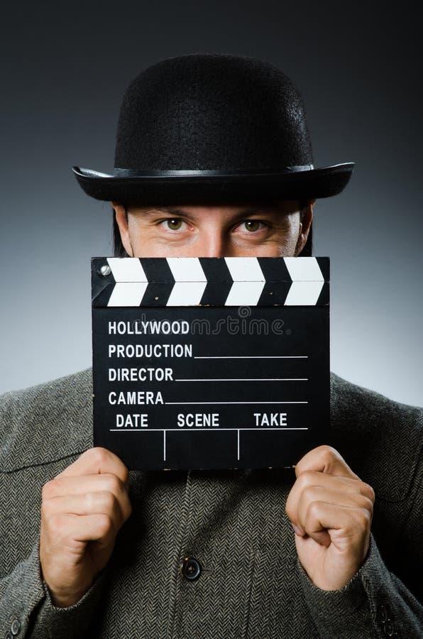 Hombre con clapperboard de la película imagen de archivo libre de regalías