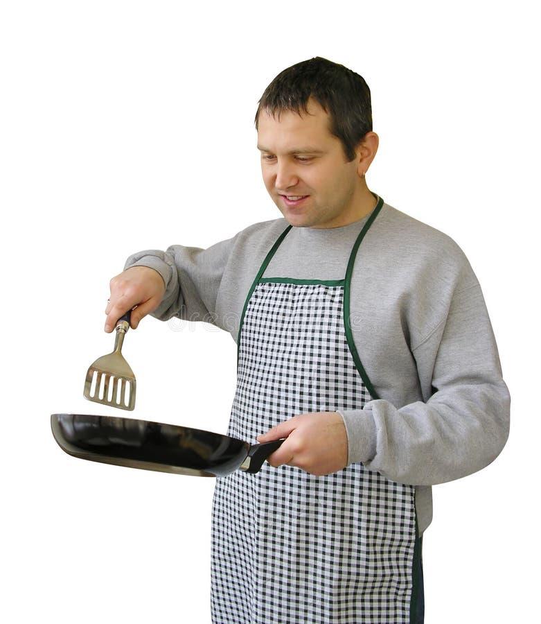 Hombre con cocinar del sartén fotos de archivo