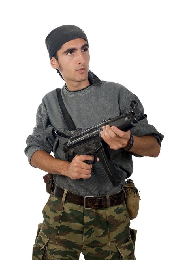 Hombre con el arma. fotos de archivo