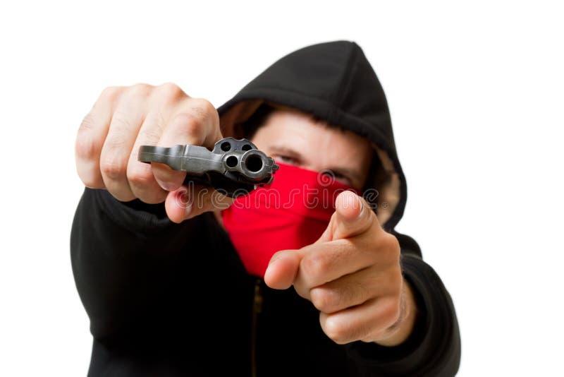 Hombre con el arma, foco en el arma foto de archivo libre de regalías
