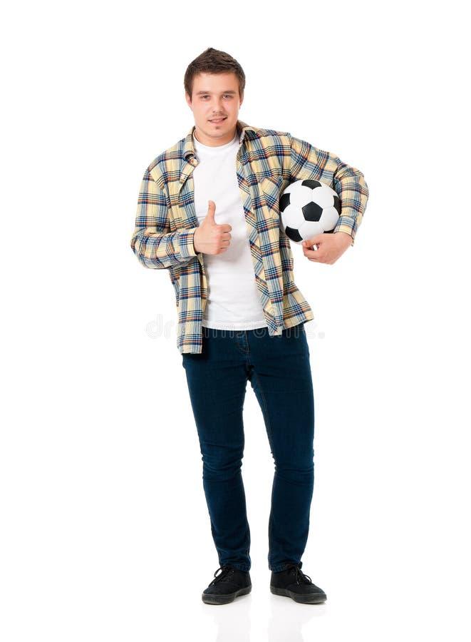 Hombre con el balón de fútbol clásico fotos de archivo
