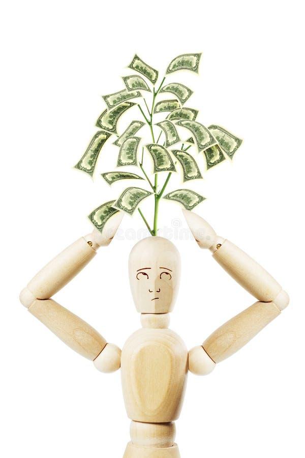 Hombre con el crecimiento de su árbol principal del dinero imagen de archivo libre de regalías