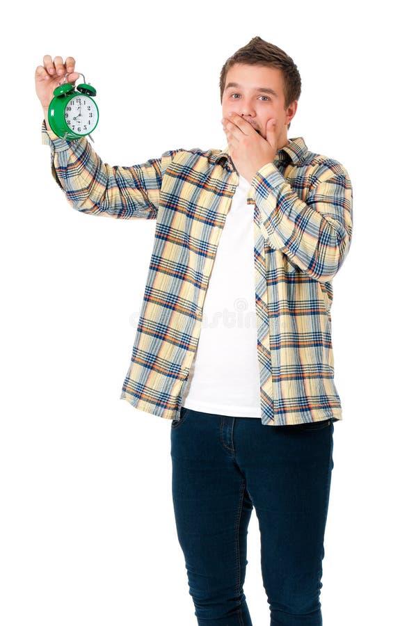 Hombre con el despertador imágenes de archivo libres de regalías