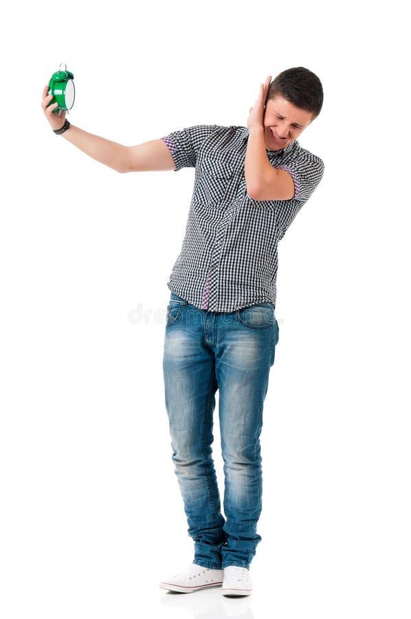Hombre con el despertador imagen de archivo libre de regalías
