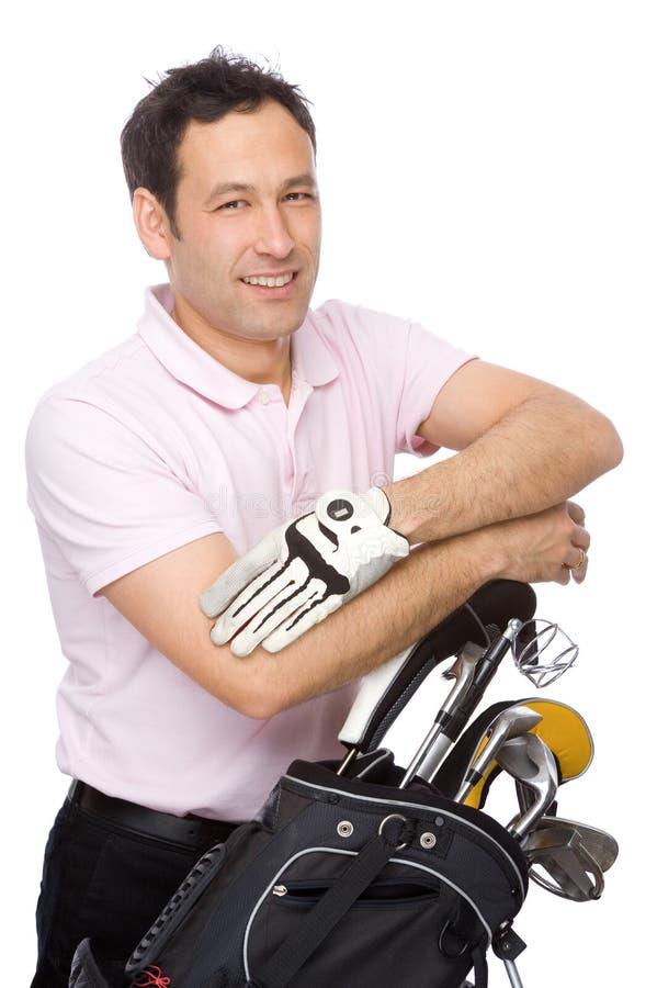 Hombre con el kit del golf foto de archivo