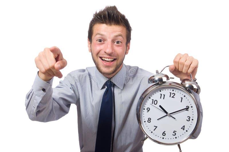 Hombre con el reloj que intenta cumplir el plazo imagenes de archivo