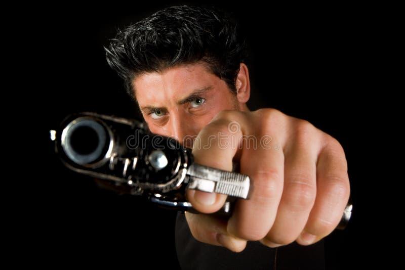 Hombre con el revólver imagenes de archivo
