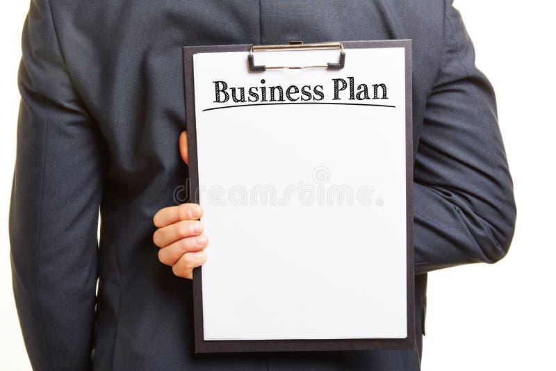 Hombre con el tablero y el lema del plan empresarial foto de archivo libre de regalías