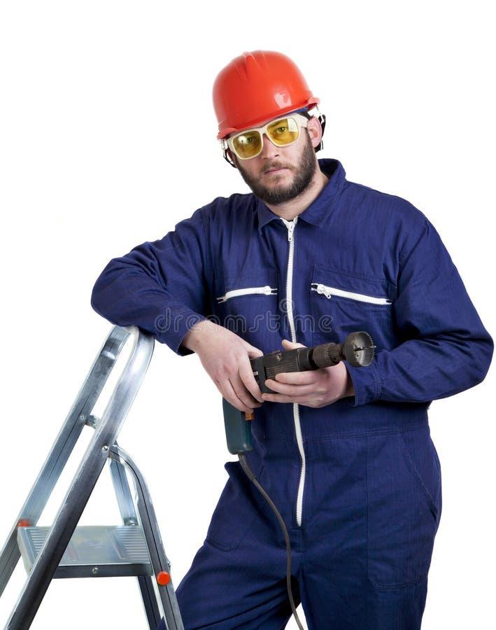 Hombre con el taladro imagen de archivo libre de regalías